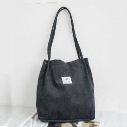 Modna skórzana torebka damska sztruksowa na ramię długie paski stylowy worek pojemna na zatrzask biała czarna