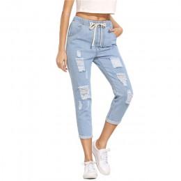 Długie spodnie jeansowe wiązane w pasie z przetarciami modne jegginsy denim elastyczne