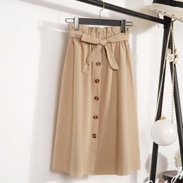 Modna elegancka spódnica midi z naturalnego materiału do kolan wiązana w talii zdobiona bursztynowymi okrągłymi guziczkami