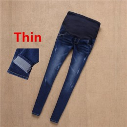 Jeansowe spodnie dla kobiet w ciąży w szerokim pasem elastyczną gumą granatowe niebieskie modne
