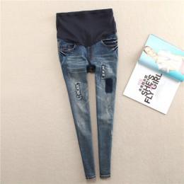 Modne spodnie damskie ciążowe długie dżinsy w stylu slim fit z przetarciami na nogawkach elastyczny regulowany pas
