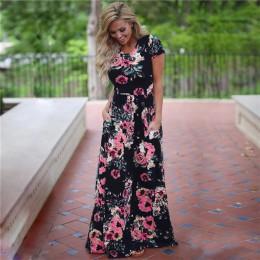 Modna długa zwiewna bawełniana sukienka damska z krótkim rękawkiem okrągły dekolt odcinana pod biustem obszerny dół sukni