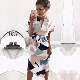 Modna elegancka sukienka damska midi z krótkim rękawkiem wiązana w pasie oryginalny dekolt w łezkę asymetryczny dół